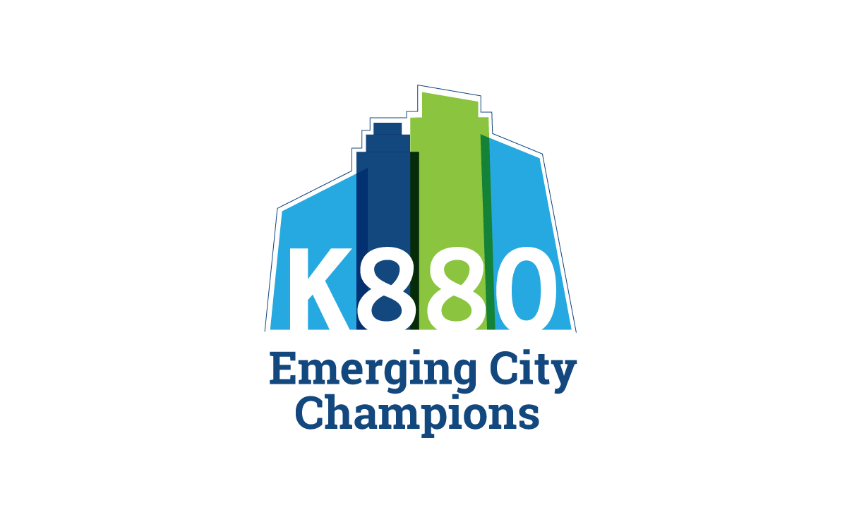 K880 Emerging City Champions Logo